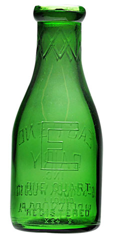Circa-1934 emerald green glass eggnog bottle from East End Dairy, Harrisburg, Pa.), 9 ¼ inches, near mint, extremely rare, est. $1,500-$3,500. Dan Morphy Auctions image.