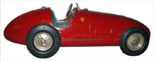 1950s Toschi Ferrari, original windup motor, retains original box. Mosby & Co. image.