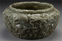 Chinese carved jade mortar, 10¼ inches tall, late 19th/early 20th century, spinach-colored jade, motif features scrolling dragons, clouds, waves, sold through LiveAuctioneers.com for $14,760. Image courtesy Jackson's International.