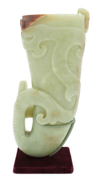Chinese yellow jade rhyton, 10 inches tall, relief carved with spiraling design, sold through LiveAuctioneers.com for $17,360. Image courtesy Leslie Hindman Auctioneers.