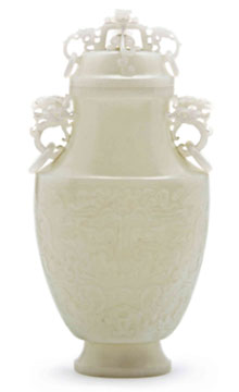 White jade vase with cover, 10 inches tall, ovoid with lion-form finial, sold through LiveAuctioneers.com for $22,320. Image courtesy Leslie Hindman Auctioneers.