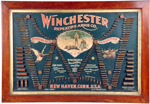 Winchester Repeating Arms advertising board displaying various types of shells and ammunition. Estimate $15,000-$25,000. Morphy Auctions image.