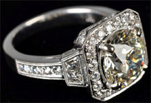 14K white gold Art Deco diamond ring with 3.04-carat center diamond in champagne or pale yellow color, and 1.02 carats of surrounding diamonds. Estimate $15,000-$25,000. Morphy Auctions image.