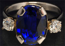 14K white gold ring with 4.37-carat deep blue oval sapphire and diamonds weighing 0.36 carats. Estimate $4,000-$8,000. Morphy Auctions image.