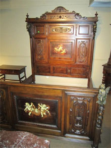 19th-century king-size custom walnut bed inlaid with pearl and ivory, $8,625.