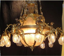 French Neoclassical 12-light bronze chandelier with crystal and bronze chains, $11,500. Don Presley Auctions image.