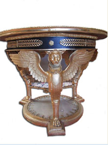 Bronze and onyx table with gilt griffins forming its base, $11,500. Don Presley Auctions image.