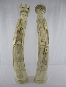 Chinese carved ivory emperor and empress. Don Presley Auctions image.