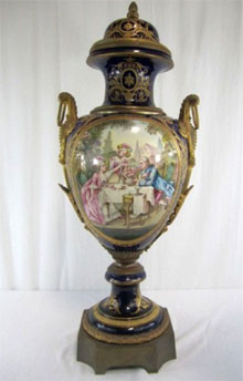 Sevres 19th century lidded urn, 40 inches tall. Don Presley Auctions image.