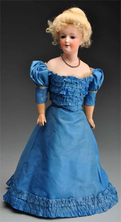 Heubach 7925 lady doll, 17 inches tall in original silk gown, est. $1,500-$2,500. Morphy Auctions image.
