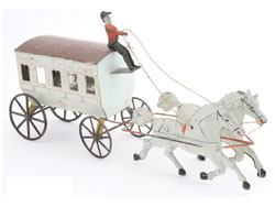 "George Brown painted-tin horse-drawn omnibus stenciled ""Broadway & Central Park,"" $12,980. Noel Barrett Auctions image."