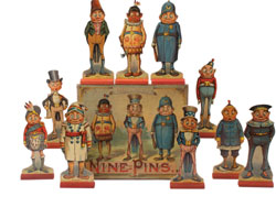 Set of McLoughlin paper litho on wood Brownie ninepins, $7,670. Noel Barrett Auctions image.