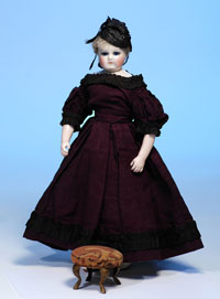 Circa-1850s Mme. Leontine Rohmer poupee with rare swivel neck and cobalt glass eyes, 14 inches, $6,325. Image by Frasher's Doll Auctions.
