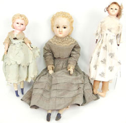 A trio of antique wax dolls. Stephenson's Auction image.