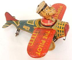 Circa-1940 Popeye the Pilot tinplate windup toy. Stephenson's Auction image.
