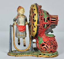 J. & E. Stevens Girl Skipping Rope cast-iron mechanical bank, $16,000-$22,000. Morphy Auctions image.