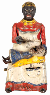 Kyser & Rex cast-iron Mammy with Spoon mechanical bank, red-dress version, patented 1884, est. $4,000-$7,000. Morphy Auctions image.