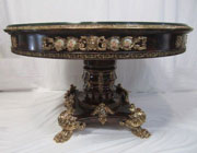 Linke-inspired glass-topped table with gilt bronze and hand-painted porcelain plaques and cartouches, paw feet; one of two to be auctioned. Don Presley Auctions image.