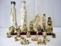 Selections from a vast array of Asian carved ivory that includes king and queen figures, a set of 7 immortals, chess set and collection of 100 netsukes. Don Presley Auctions image.