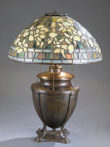 Circa-1905 Tiffany Studios 'Daffodil' table lamp with bronze urn-form base, multiple stamps and signatures on shade and base, est. $15,000-$20,000. Quinn's Auction Galleries image.