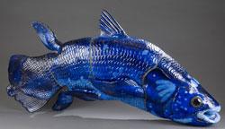 Royal Copenhagen glazed cobalt-blue porcelain coelacanth. Designed by Jeanne Grut (b. 1927-) est. $3,000-$4,000. Quinn's Auction Galleries image.