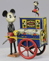 Distler Mickey Mouse Hurdy Gurdy with miniature dancing Minnie Mouse, $8,050. Bertoia Auctions image.