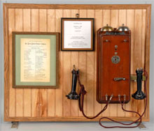 Circa-1878 Watts & Co. coffin-shape telephone offered with a copy of the first telephone directory, est. $10,000-$20,000. Morphy Auctions image.