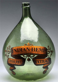 From a 35-year apothecary collection, a 16 ½ in. green demijohn or carboy apothecary show bottle with gold label identifying 'Indian Hemp Fluid Extract.' Est. $250-$500. Morphy Auctions image.
