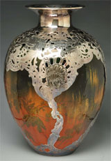 Monumental Rookwood pottery vase attributed to Valentien, with heavy silver overlay created by Gorham Silver Co., 14 in. tall. Made for the 1893 Columbian Exposition in Chicago. Est. $30,000-$50,000. Morphy Auctions image.