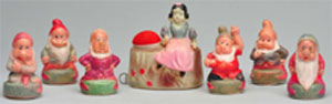 Set of Snow White and (6) Dwarfs celluloid tape measures, est. $2,000-$3,000. Morphy Auctions image.
