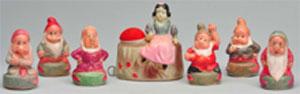 Set of Snow White and (6) Dwarfs celluloid tape measures, est. $2,000-$3,000. Morphy Auctions image.