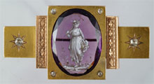 Yellow gold Victorian brooch set with 28mm by 20mm enameled, faceted amethyst. William H. Bunch Auctions image.