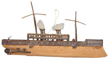 Dresden Christmas ornament of a freighter with billowing smokestacks, est. $2,000-$3,000. Morphy Auctions image.