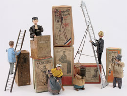 Selection of boxed antique clockwork character toys by the French maker Fernand Martin. Noel Barrett Auctions image.