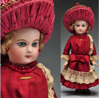 Beautifully dressed early Jumeau bebe doll, 14 in., French bisque socket head incised 'Depose E 5 J.' Est. $6,500-$8,500. Morphy Auctions image.