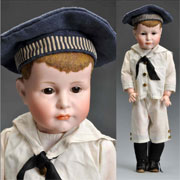 Kammer & Reinhardt 114 character boy doll, 20 in., bisque socket head incised 'K*R 114 49.' Est. $6,500-$9,500. Morphy Auctions image.