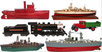 A sampling of the many scarce Buddy L toys, boats and trains, plus (upper right) a rare 37-inch Orkin battleship. Old Town Auctions image.