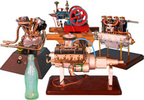 "A collection of miniature working engines includes hit-and-miss style engines, and engines for a Harley-Davidson ""Knucklehead"" and Chevy small block V8. Old Town Auctions image."