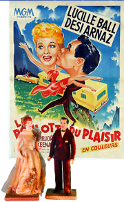 French poster and Lucy/Desi figures rom an important and extensive collection of 'I Love Lucy' posters and collectibles. Old Town Auctions image.