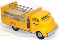 Smith-Miller pressed-steel and wood Coca-Cola delivery truck, complete with wood Coke crates. John W. Coker Auctions image.