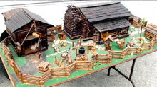 Handmade tableau consisting of a farmhouse, two-story barn, outbuildings, split-rail fence and dozens of miniature accessories. John W. Coker Auctions image.