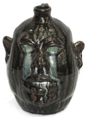 Lanier Meaders face jug, from a collection of Southern pottery. John W. Coker Auctions image.