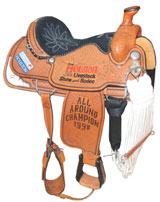 1998 Ty Murray Houston Livestock Show & Rodeo All-Around Championship saddle trophy. Consigned by Murray and his wife, Jewel, to benefit a Texas children's charity. Grey Flannel Auctions image.