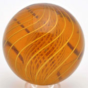 Amber glass latticino swirl marble, 1 5/8 inches in diameter with 14 birdcage latticino bands, ex Paul Baumann collection, est. $4,000-$6,000. Morphy Auctions image.