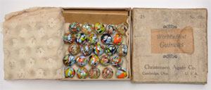 Christensen Agate No. 00 Guinea Marbles boxed set, believed to be the only extant example of this set, contains 13 blue guineas and 12 clear specimens. Provenance: John Early, marble grader for Christensen Agate Co. Est. $9,000-$12,000. Morphy Auctions image.