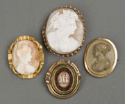 Four examples from a large selection of rare antique cameos. Quinn's Auction Galleries image.