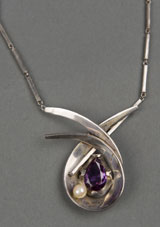 Circa-1953 Antonio Pineda (Mexico, 1919-2009) sterling silver pendant with sizable amethyst and accent pearl on handmade silver-link necklace, est. $900-$1,000. Quinn's Auction Galleries image.