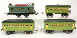 Lionel prewar O gauge passenger set with No. 253 locomotive, two No. 607 Pullman coaches and a No. 608 observation car. Stephenson's image.
