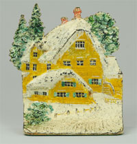 Hand-painted cast-iron doorstop depicting snow-capped cottage, book example, $5,175. Bertoia Auctions image.