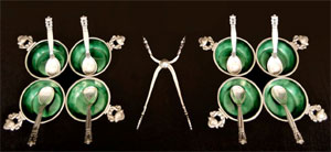 From a Georg Jensen sterling silver flatware set in the Acorn pattern, eight emerald-enameled salts with spoons